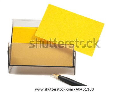 Yellow blank business card in holder, with pen. - stock photo