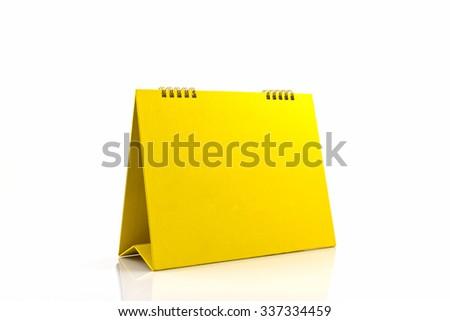 Yellow blank paper desk spiral calendar on white background.  - stock photo