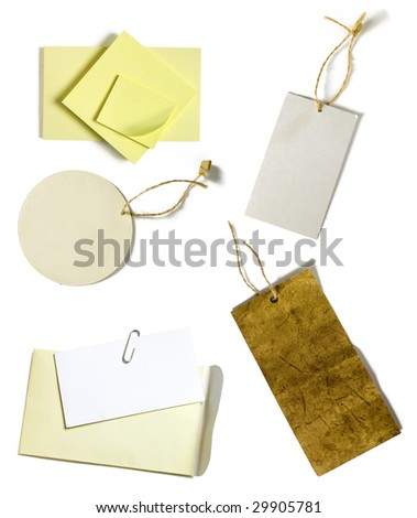 yellow blank post-it sheets and blank paper tags - stock photo