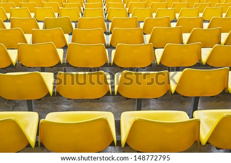 Yellow bleacher seats in one of the highend racetracks in the Philippines.