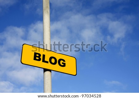 Yellow blog sign against a blue sky - stock photo