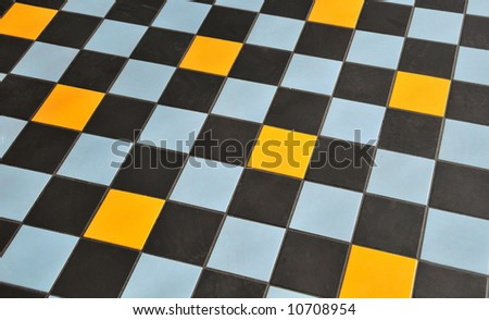 Yellow, Blue, and Black tile floor background.