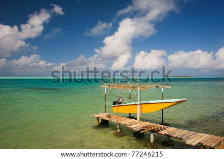Yellow boat and turquoise water of Pacific, Maupiti, French Polynesia, Society Islands