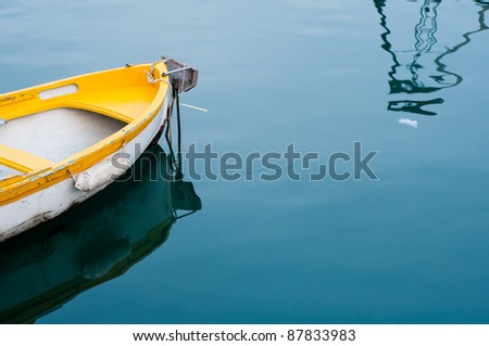 yellow boat in the dock - stock photo