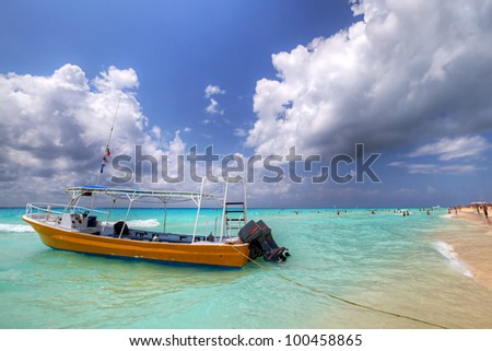 Yellow boat on the coast of Caribbean Sea - Mexico - stock photo