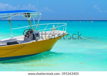 Yellow boat on the coast of Caribbean Sea, Mexico - stock photo
