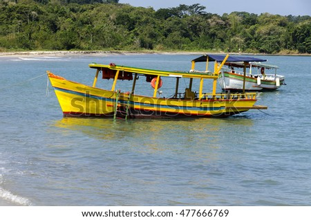 yellow boat on the island of bald in Paraty Brazil