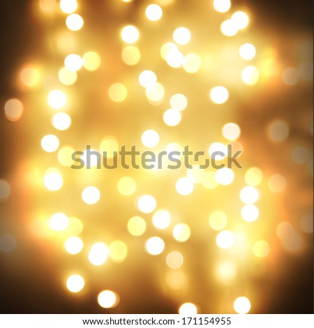 yellow bokeh, defocused lights good for christmas or other celebrations - stock photo