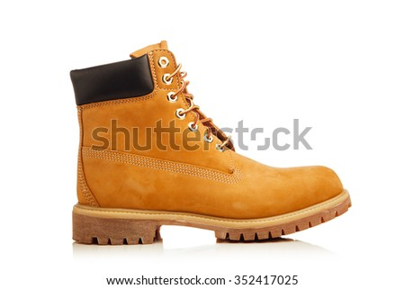 yellow boot isolated on white - stock photo