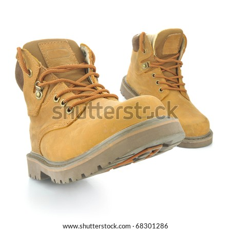 yellow boots isolated on white - stock photo