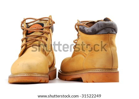 Yellow boots on a thick sole for heavy work and walks.