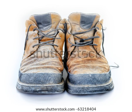 Yellow boots with a shoelaces isolated on white background