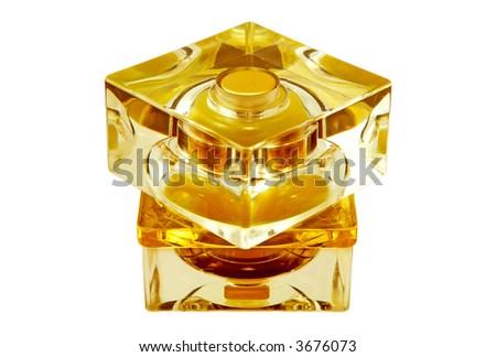 yellow bottle of perfume. Close-up. Isolated on white. - stock photo