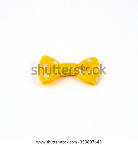 Yellow bow tie isolated on white background.