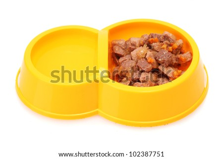 yellow bowl with cat food and water isolated on white - stock photo