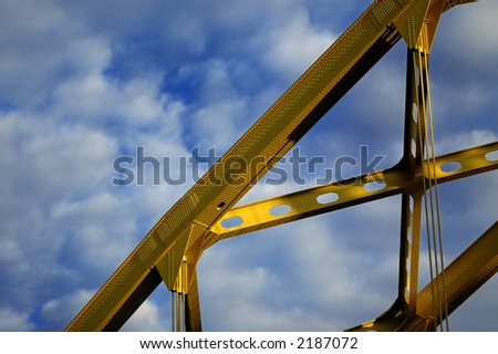 yellow bridge with blue sky and clouds - stock photo