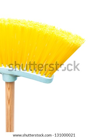yellow brush the floor on a white background