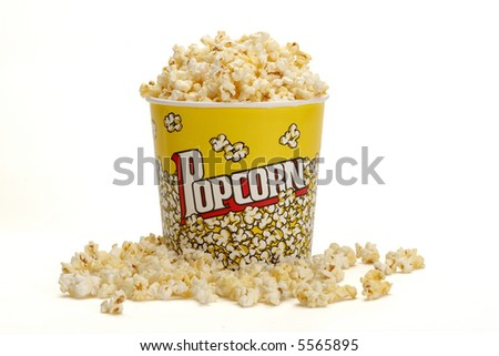Yellow Bucket of Popcorn Spilling Over - stock photo