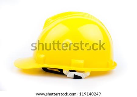 yellow builder hardhat isolated on white - stock photo