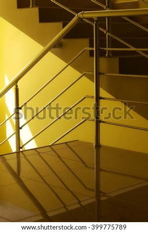 Yellow building hall, detail stairs and hallway background - stock photo