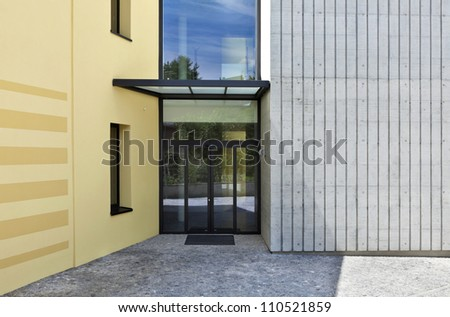 yellow building, view of entry - stock photo