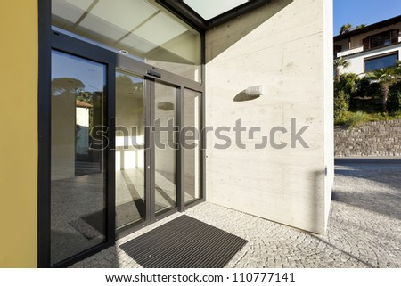yellow building, view of entry, outdoor - stock photo