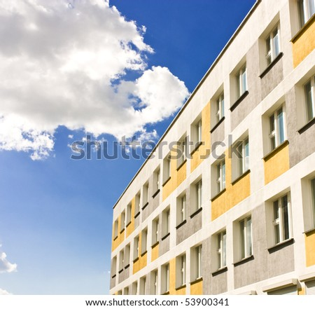 Yellow Building with Windows - stock photo
