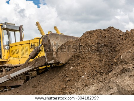 Yellow bulldozer - stock photo