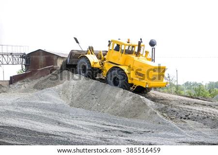 Yellow bulldozer working digging  - stock photo