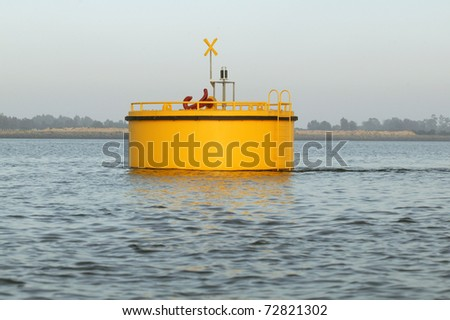 Yellow buoy on a blue water