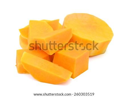 yellow butternut squash cut blocks isolated on white  - stock photo
