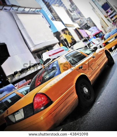 Yellow Cab in high contrast color and vignette speeding through Times Square New York - stock photo
