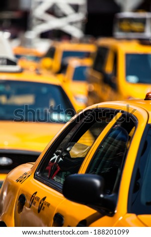 Yellow cab speeds through Times Square in New York, NY, USA.  - stock photo