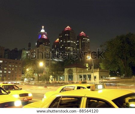 Yellow cabs along Manhattan's Union Square and 17th street in New York City. Pavillion is also in view. - stock photo