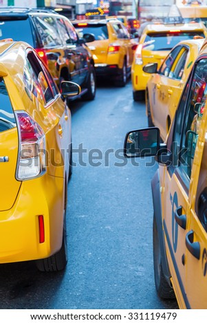yellow cabs in a traffic jam in Manhattan, New York City,  - stock photo