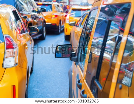 yellow cabs in Manhattan, New York City, in a traffic jam - stock photo