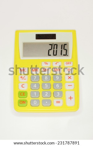 Yellow calculator isolated on white background - stock photo