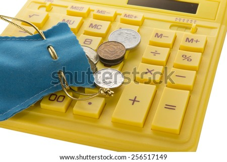 yellow calculator with Blue bag and coins - stock photo
