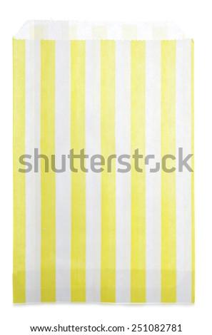 yellow candy stripe sweet bag cutout - stock photo