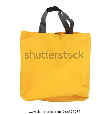 yellow canvas shopping bag isolated on white background - stock photo