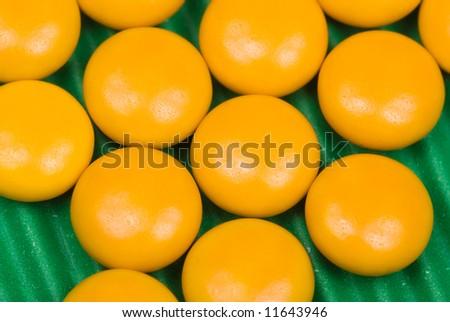 Yellow Capsules, close up - stock photo