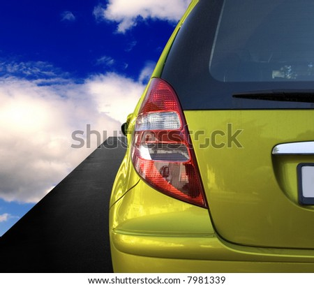 Yellow car on the road - stock photo