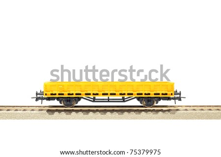 yellow cargo carriage railroad toy model, H0 scale, isolated on white with clipping path - stock photo