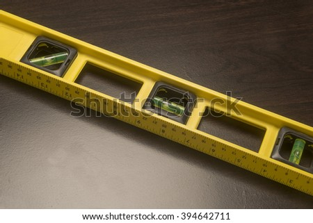 Yellow carpenter's level/Carpenter's Level/Yellow level used for precision building - stock photo