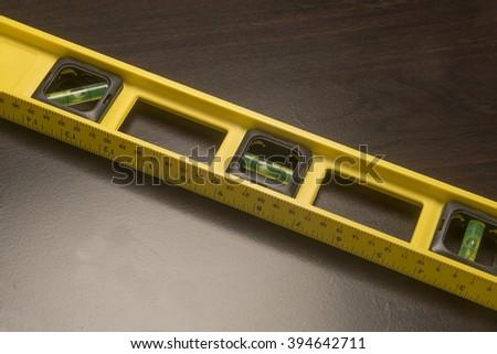 Yellow carpenter's level/Carpenter's Level/Yellow level used for precision building - stock photo