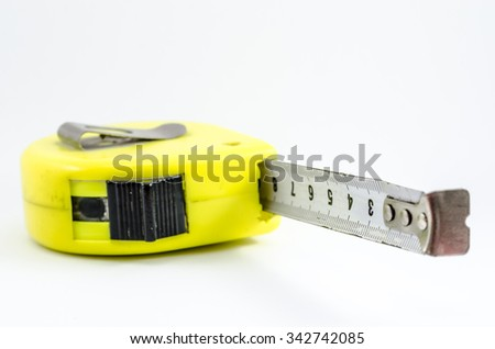 Yellow case used measuring tape. Isolated in white. Measuring tool.