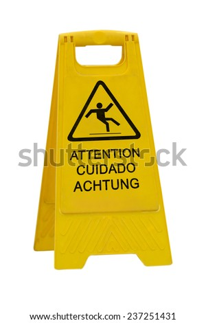 Yellow Caution slippery wet floor sign labeled in English/French, Spanish and German Language isolated on white background - stock photo