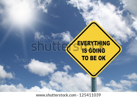 Yellow cautionary road sign Everything is going to be OK - stock photo