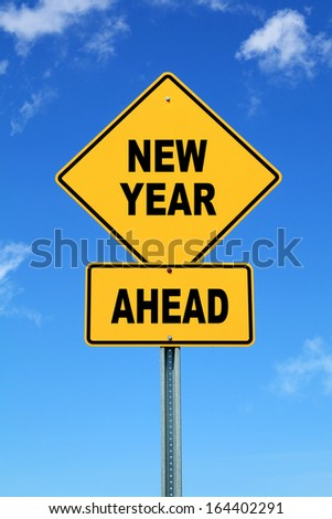 Yellow cautionary road sign new year ahead - stock photo