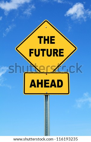 Yellow cautionary road sign The Future Ahead against a blue sky - stock photo